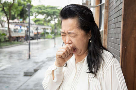 Old asian woman having knee joint pain or knee injury problem