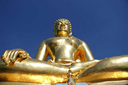 subduing: Golden Buddha in the attitude of subduing Mara manner located at golden triangle