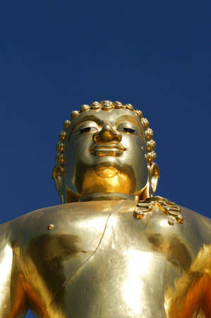 subduing: Buddha in the attitude of subduing Mara manner located at golden triangle  Stock Photo