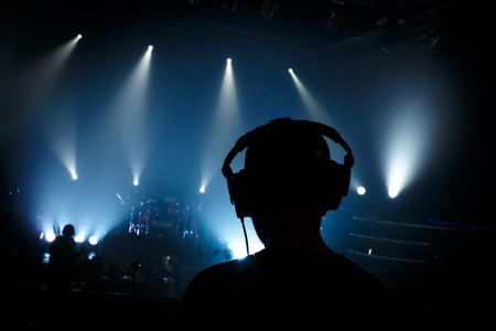Black silhouette sound manager on rock concert