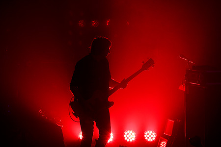 croud: Black silhouette of guitarist at rock concert