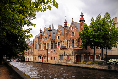 patronage: Shot of historic medieval buildings along a canal in Bruges, Belgium, Brugge