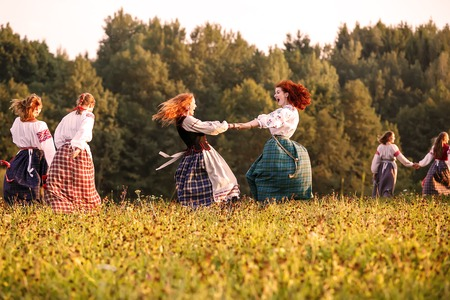 latvia girls: Minsk, Belarus - september 2015,  Circular dance by girls  dressed in national belarus clothes at authentic country festival