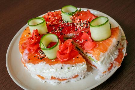 cutoff: Salmon Sushi Cake with nigiri, soy sauce, cucumber, salmon, avocado, caviar nori sesame Cutoff
