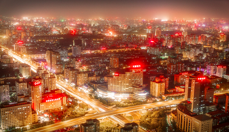 midwest usa: BEIJING - CHINA, MAY 2016: Top view from Central Radio TV Tower over the big asian city of Beijing. China at nighttime when the tall skyscrapers are illuminated on May 18, 2016.