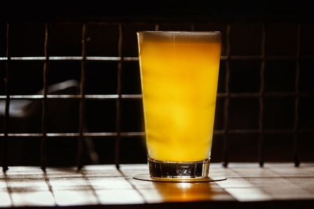 Craft Beer in Bar, Glass on table in authentic Pub Stock Photo