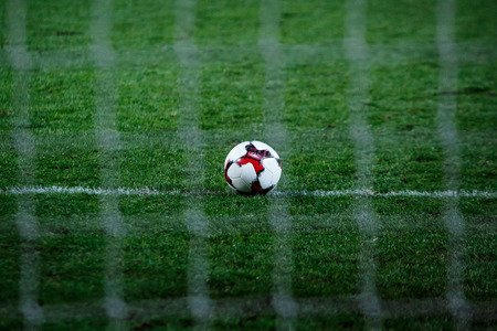 soccer net: soccer ball on soccer field, football lawn with net Stock Photo