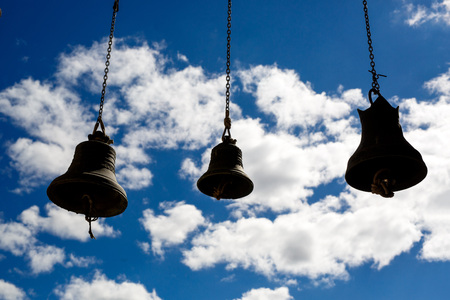Orthodox bells closeup against the sky with clouds. Stock Photo
