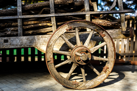 ferrous: Old wooden cartwheel from close-up. Vintage farm wagon Stock Photo