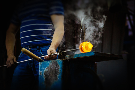 Glass master blower forming piece of glass, water cooling