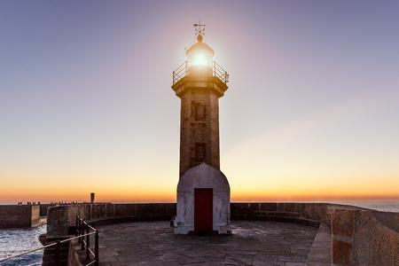 Lighthouse on the ocean, sunset