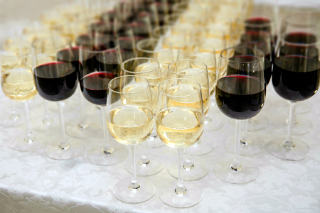 glasses with white and red wine close-up before party in cafe Reklamní fotografie