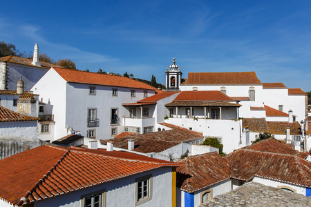 View from the City Wall of the Beautiful Village of Obidos, Portugal. White walls, blue sky