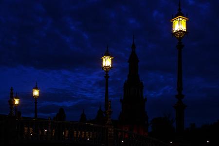 Old fashioned street light against twilight background, Sevilla, Spain