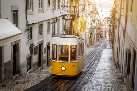 Famous old yellow tram on street of Lisbon, Lisboa, Funicular Фото со стока