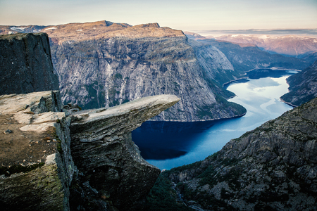 Norway tourism attraction - Trolltunga. Trolls Tongue rock in Hordaland county. Ringedalsvatnet lake.