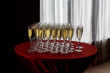 Champagne glasses standing on round table at the event party