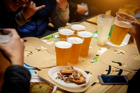 Plastic beer glasses with a beer on a friend party Stock Photo
