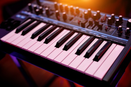 Two octaves electronic musical keyboard synthesizer close-up. 版權商用圖片