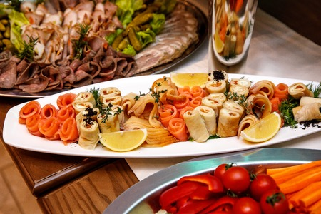 Beautifully decorated catering banquet table with different food snacks and appetizers on corporate, christmas, birthday, party, event or wedding celebration