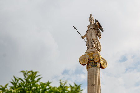 Statue of the goddess Athina, the goddess of piece, wisdom and culture, daughter of Zeus and protector of the city of Athens, Greece. The statue is right outside the Academy of Athens.