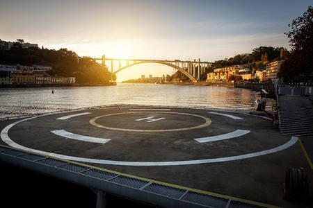 Helipad near the river, sunset time Reklamní fotografie
