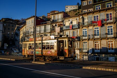 Porto, Portugal - November 13, 2018: Traditional Portuguese tram on the streets of Porto. Sunset time. First line