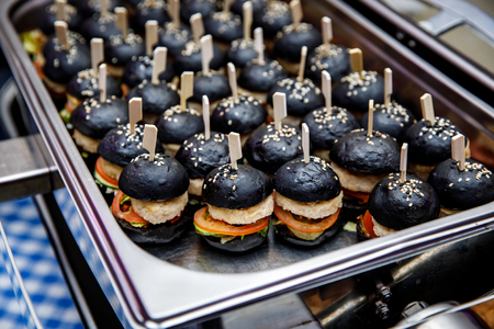 A lot of mini black burgers on event catering