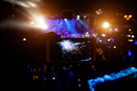 Shooting on mobile phone. Concert on stage