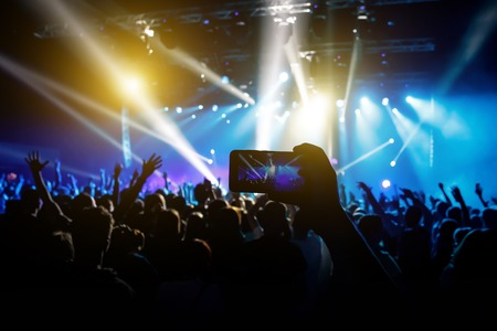 Photo for social networks at the concert, Mobile phone on music show Imagens