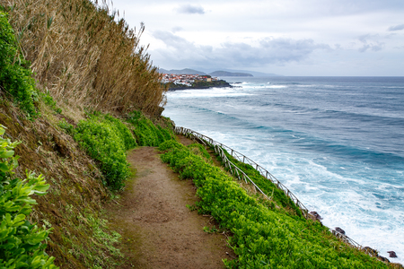 Hiking along the shore of the ocean, Stairs and background of city