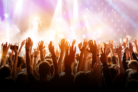 Crowd with raised hands on music concert.