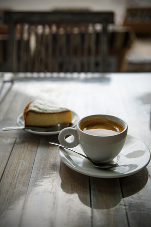 Coffee and cheesecake on table