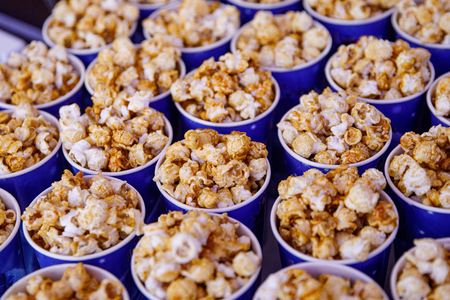 Many cups of popcorn before the movie. Top view Reklamní fotografie