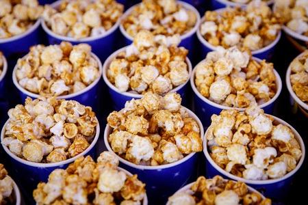 Many round popcorn cups. top view Reklamní fotografie - 122631658