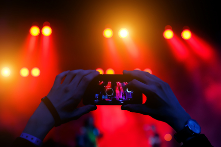 Take a picture on concert, smartphone record Reklamní fotografie