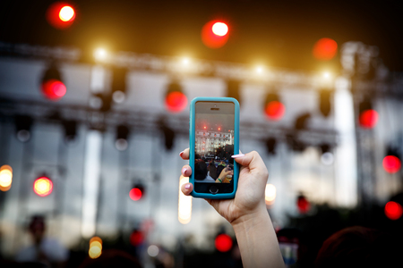 Using a mobile phone at a summer music show