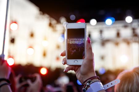 Mobile phone record the stage on summer music festival Reklamní fotografie - 122631763