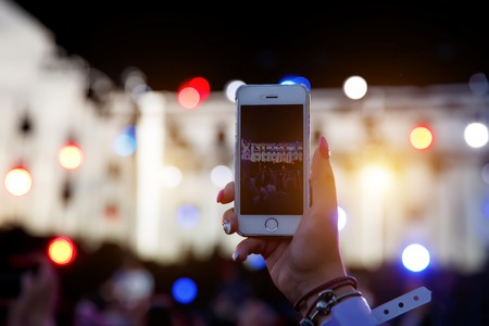 Mobile phone record the stage on summer music festival Reklamní fotografie