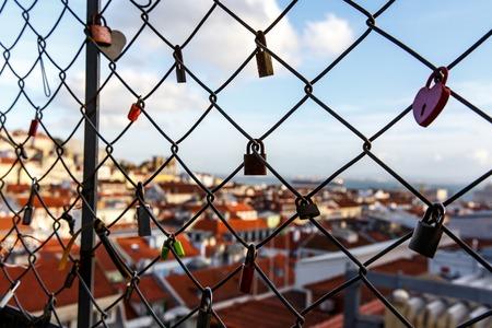 Locks on the cage, Old city on a blurred Reklamní fotografie - 123711637