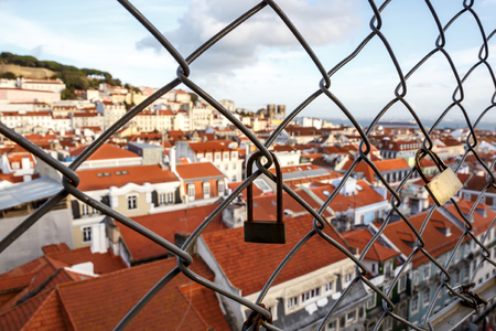 Lock on the cage, Old city on a blurred Reklamní fotografie