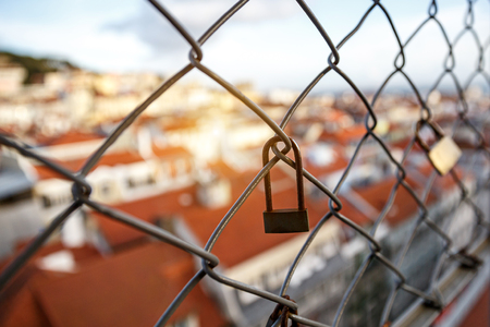 lock on the lattice. The roofs of the old city on a blurred Reklamní fotografie - 123711633