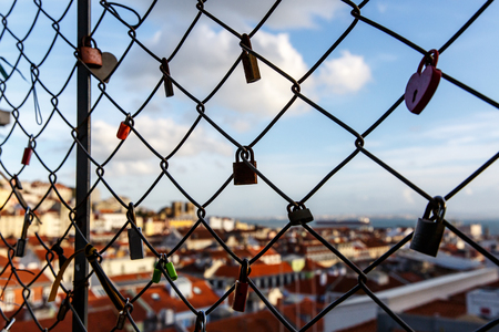 locks on the lattice. The roofs of the old city on a blurred Reklamní fotografie