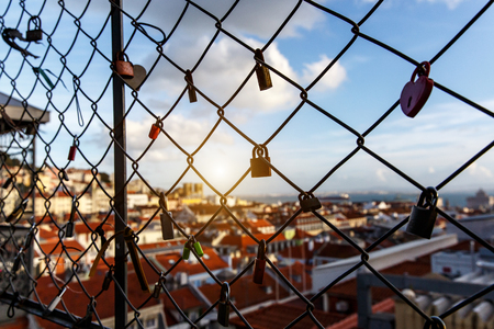 Locks on the cage, Old city on a blurred