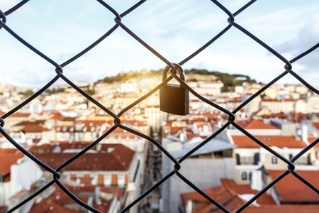 lock on the lattice. The roofs of the old city on a blurred