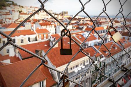 Lock on the cage, Old city on a blurred Reklamní fotografie - 123712115