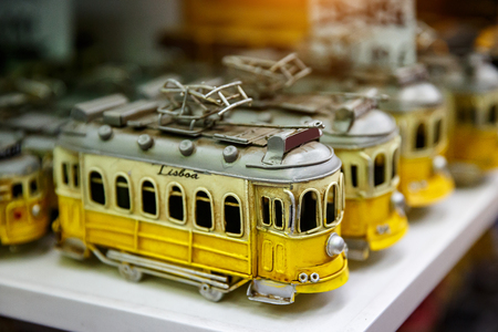 Symbol of Lisbon, a toy of the traditional yellow tram in souvenir shop Reklamní fotografie - 123712134