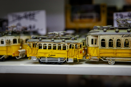 Symbol of Lisbon, a toy of the traditional yellow tram Reklamní fotografie - 123712137