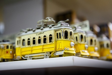 Symbol of Lisbon, a toy of the traditional yellow tram Reklamní fotografie - 123713518