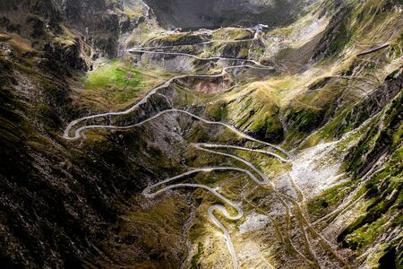 Winding mountain road. Transfagarasan is one of the most spectacular mountain roads in the world. Romania Standard-Bild - 129483813